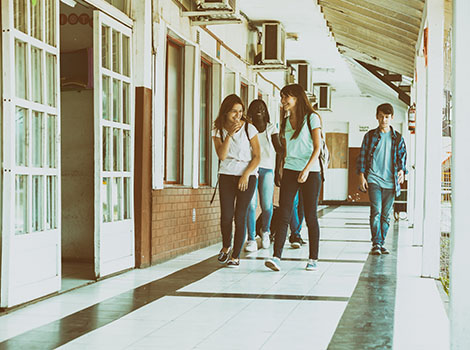 Students Walking Outside Hallway | GreenBee